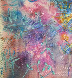 hand embroidered detail on painted cloth